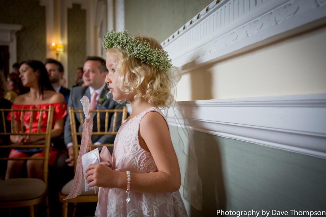 Flower girl watches the wedding ceremony at Crewe Municipal Buildings