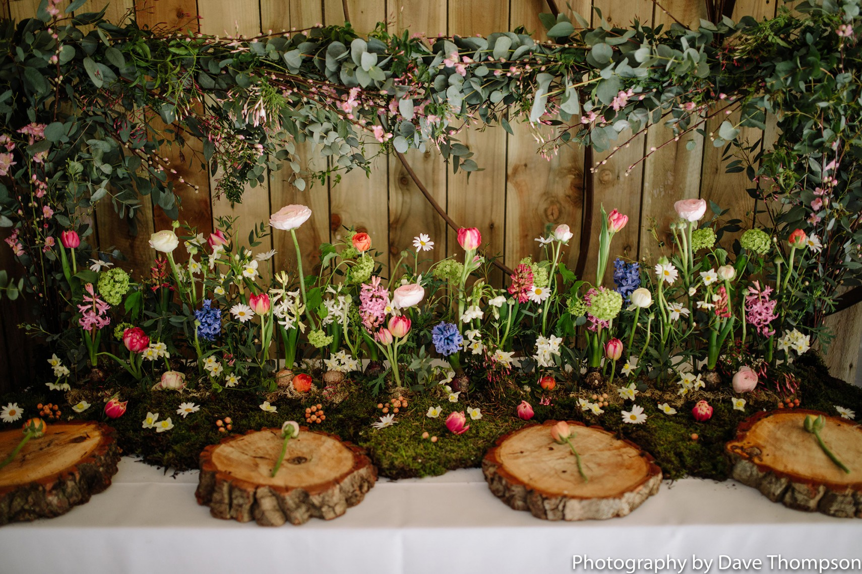 Flowers on display during the Tables dressed for a wedding at Alcumlow Wedding Barn Open Weekend