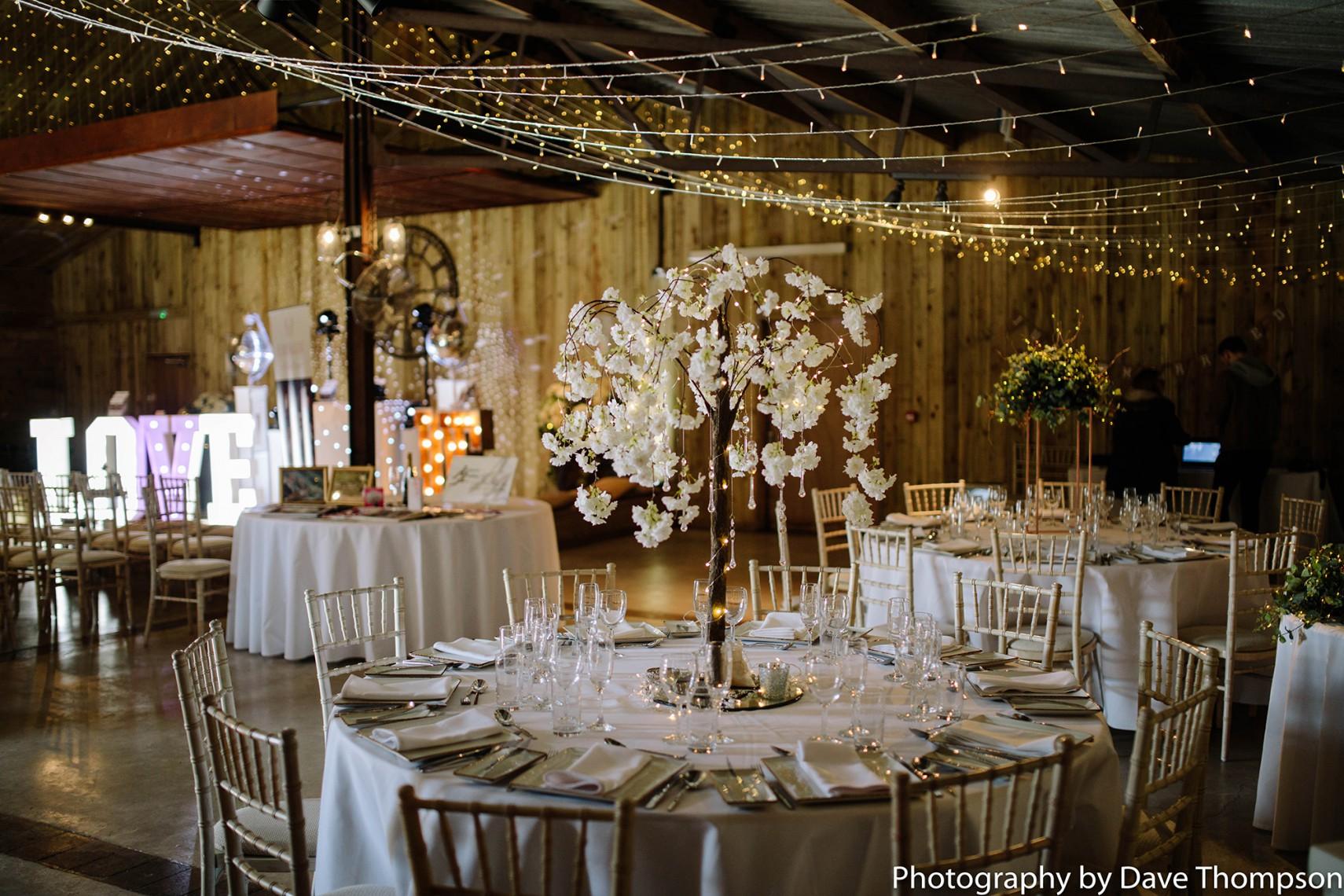 Tables dressed for a wedding at Alcumlow Wedding Barn