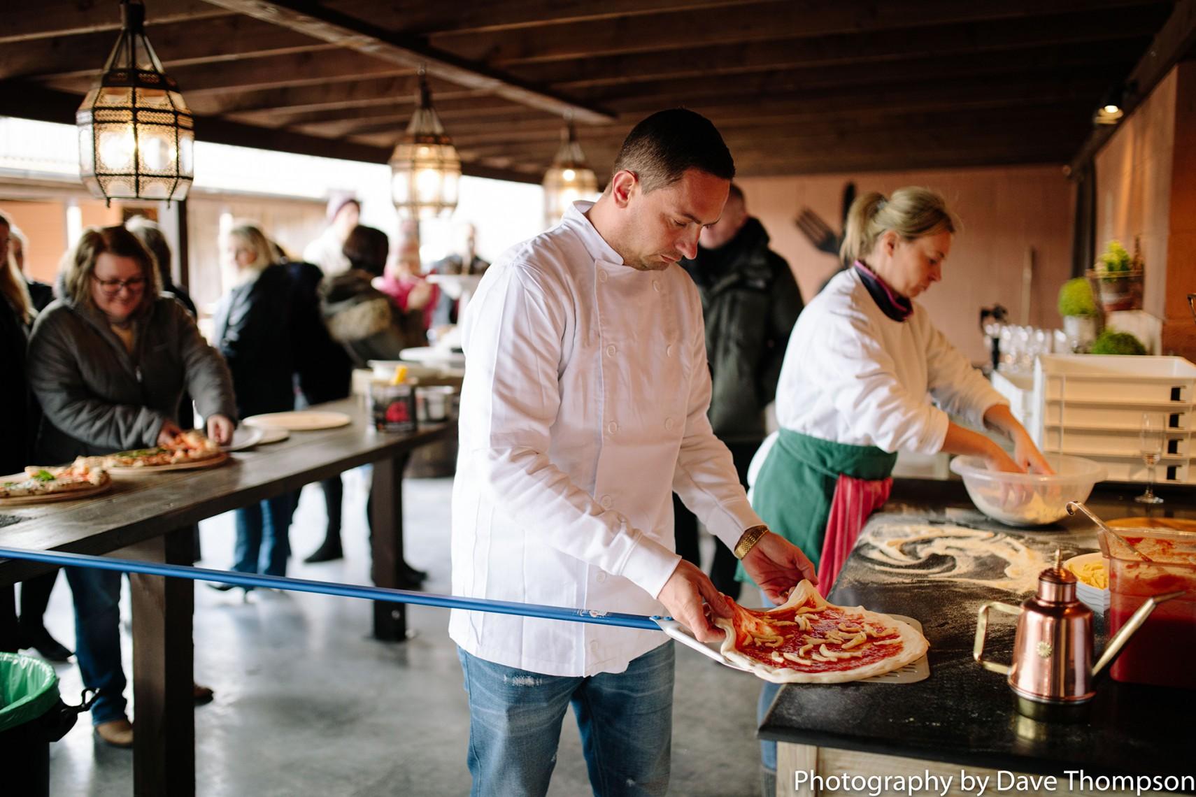 Pizza is prepared at Alcumlow Wedding Barn