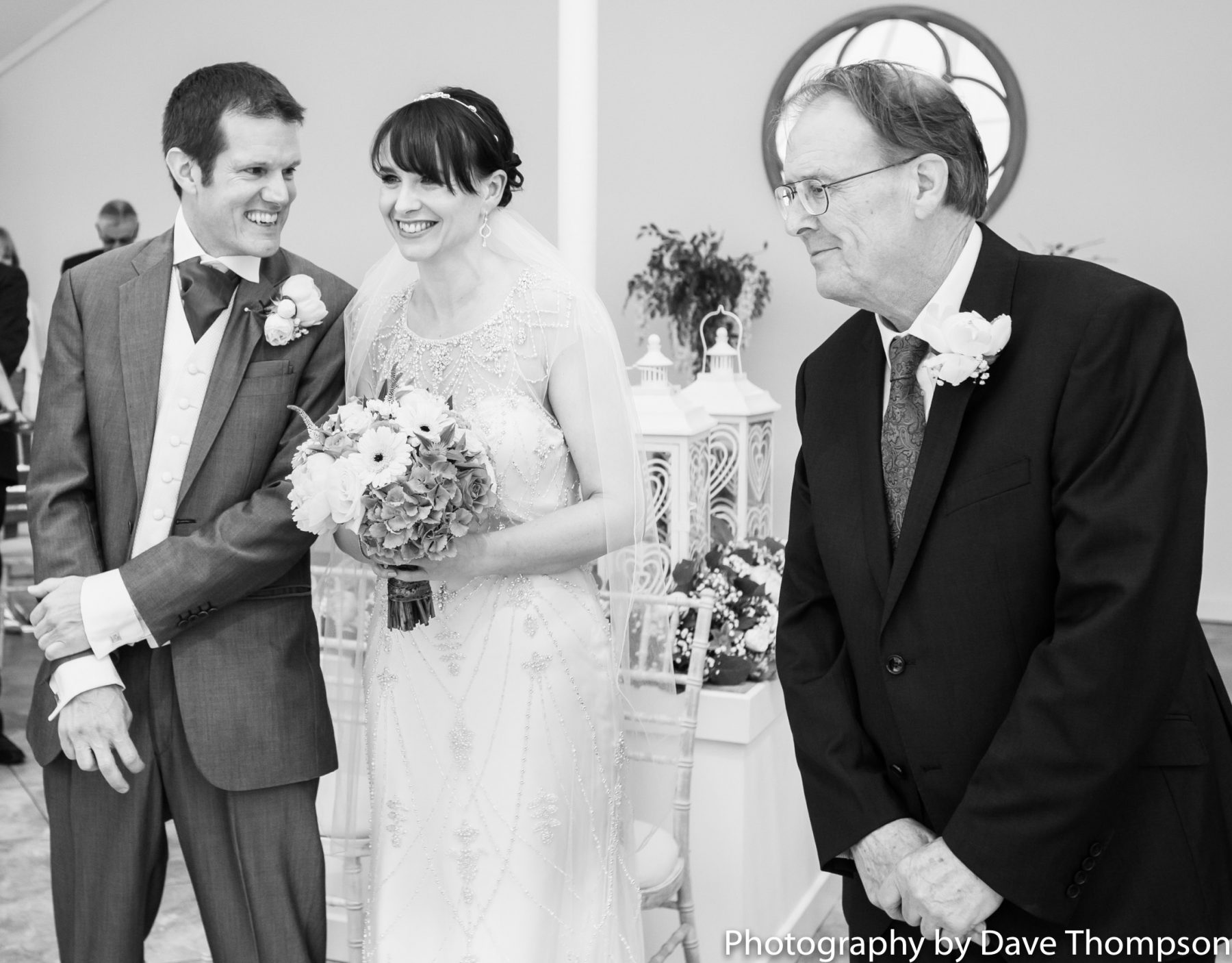 The father of the bride gives his daughter away