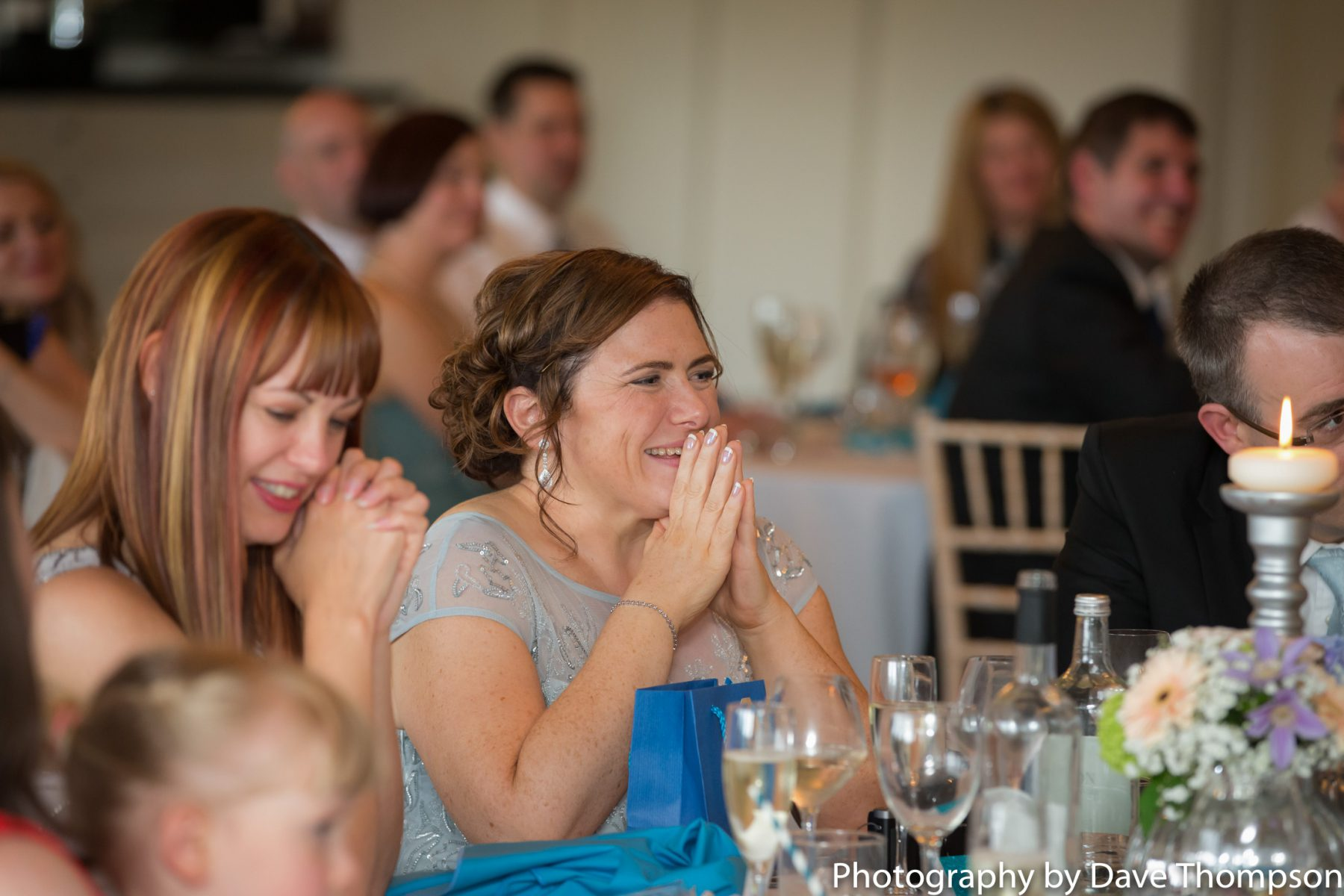A guest laughs during the speeches