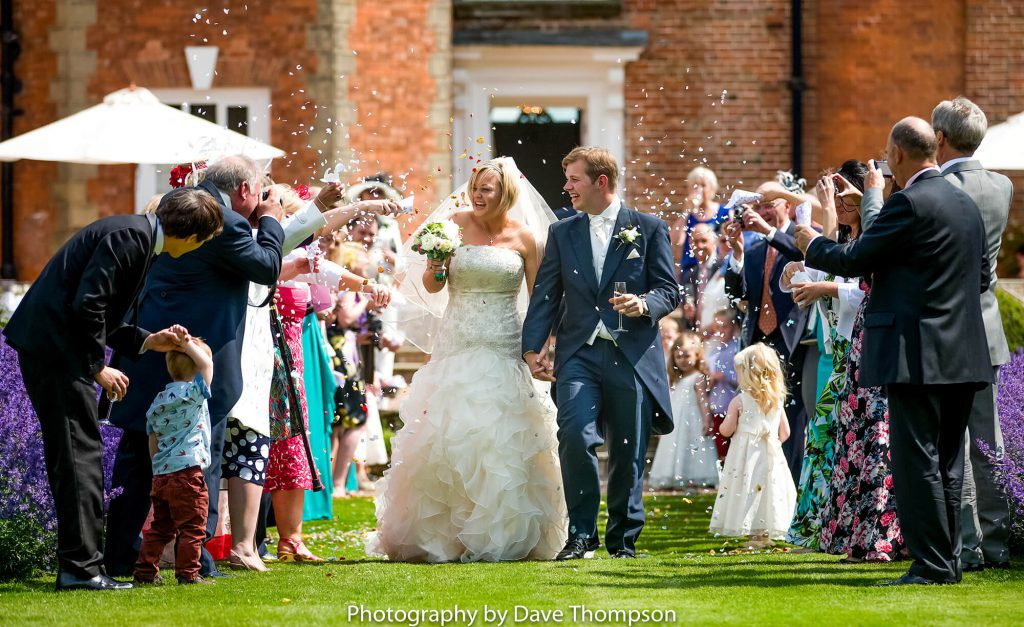 Confetti is thrown at the bride and groom
