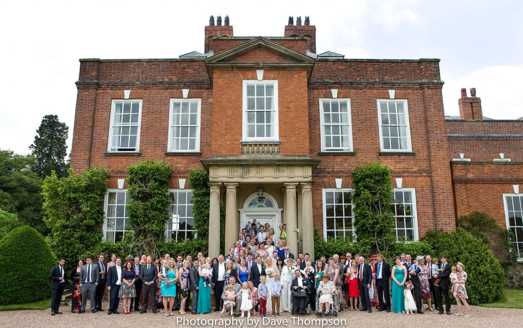 A family group photograph outside Iscoyd Park Wedding venue