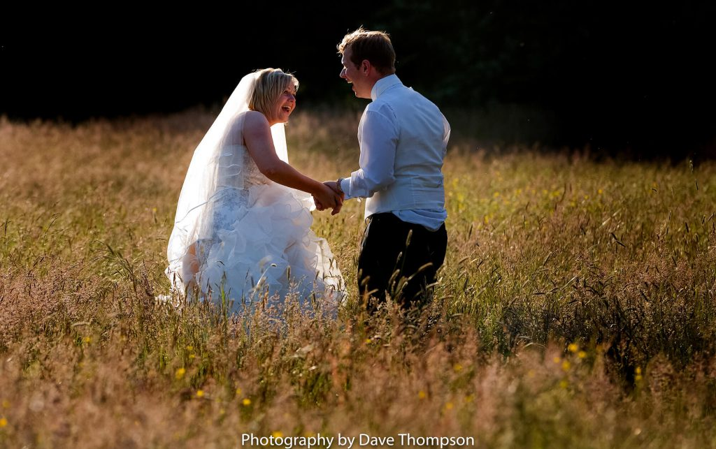 The bride and groom in the evening sunlight