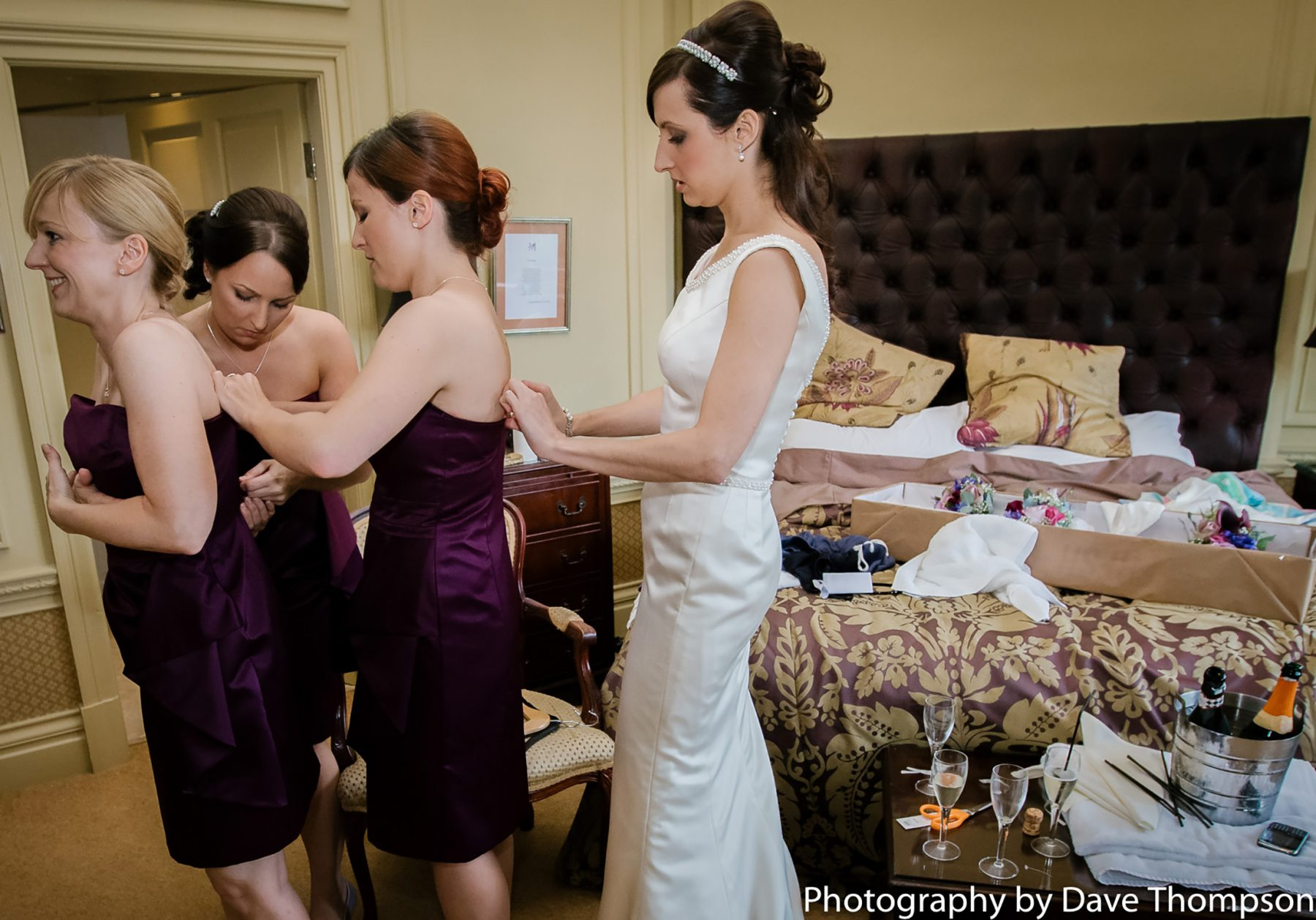 All the members of the bridal party help each other get ready