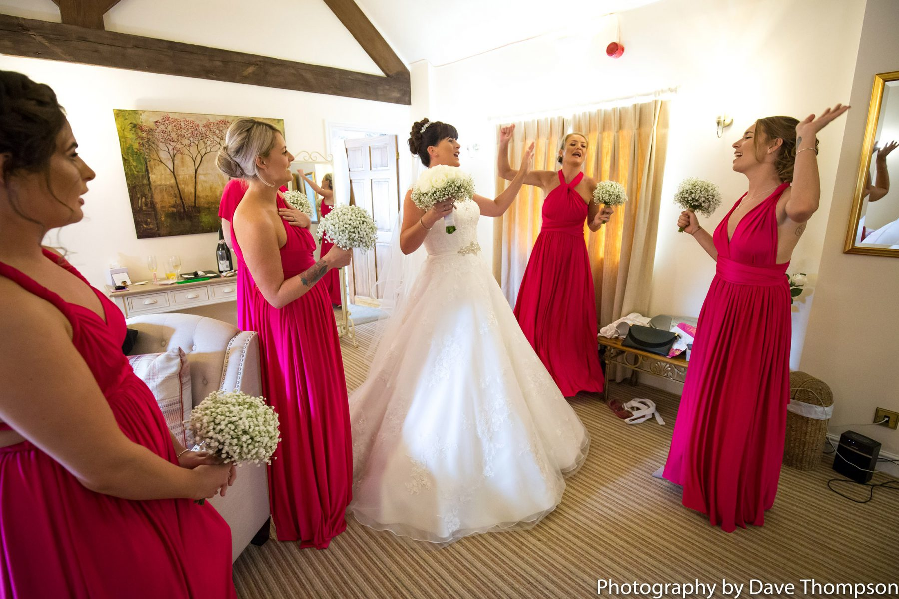 The bride dances with the bridesmaids