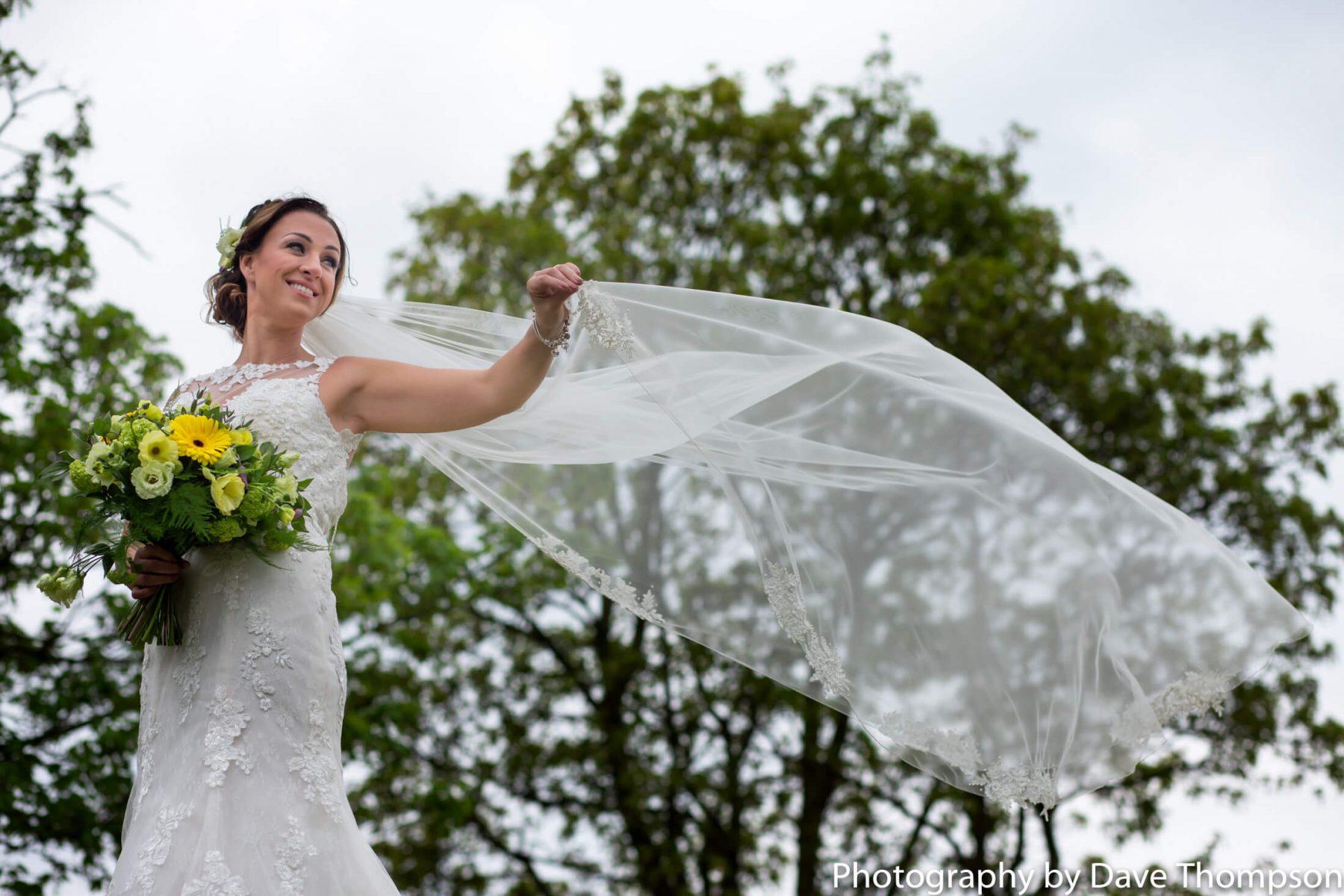 A bride waves her veil