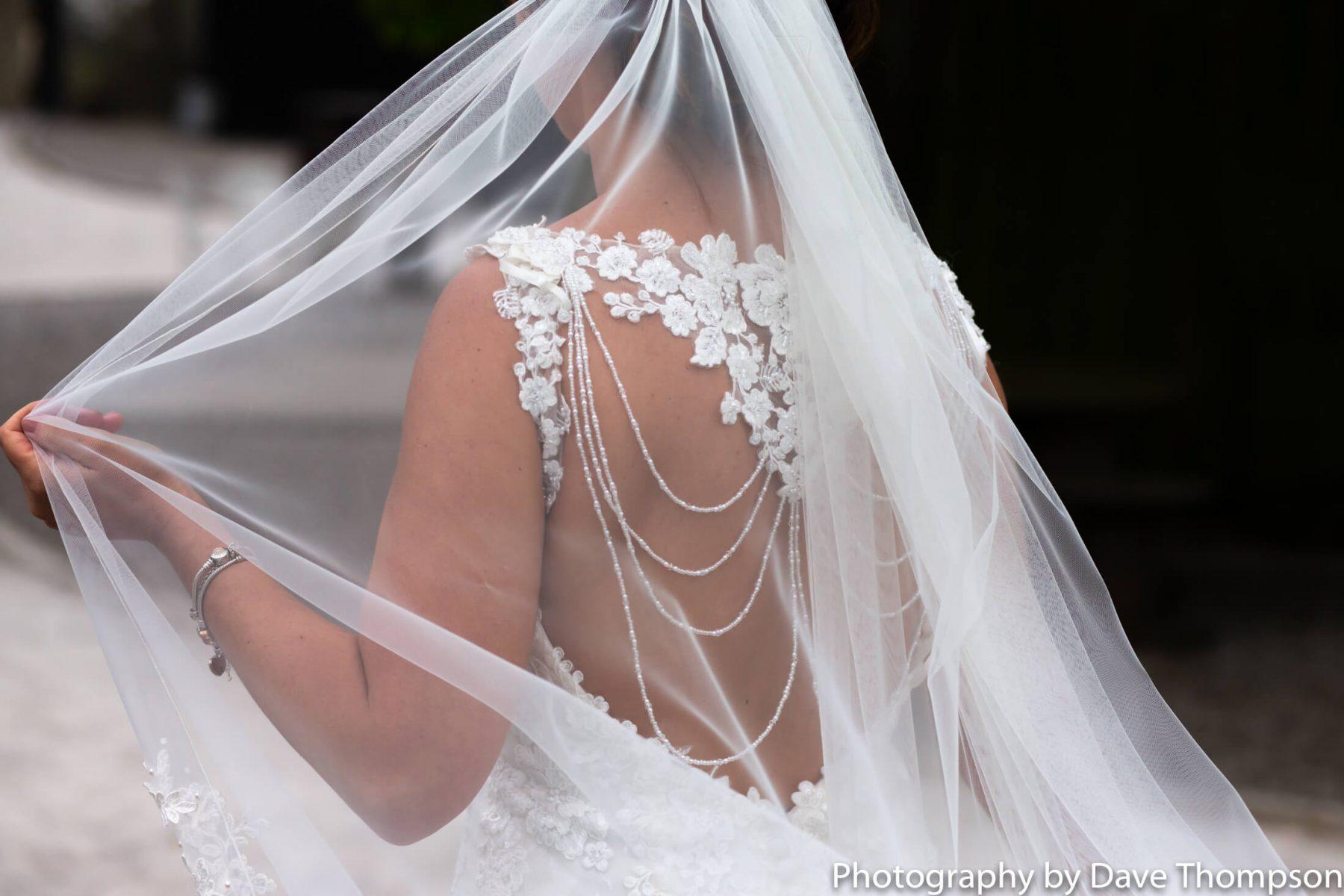 Detail shot of a dress through the veil