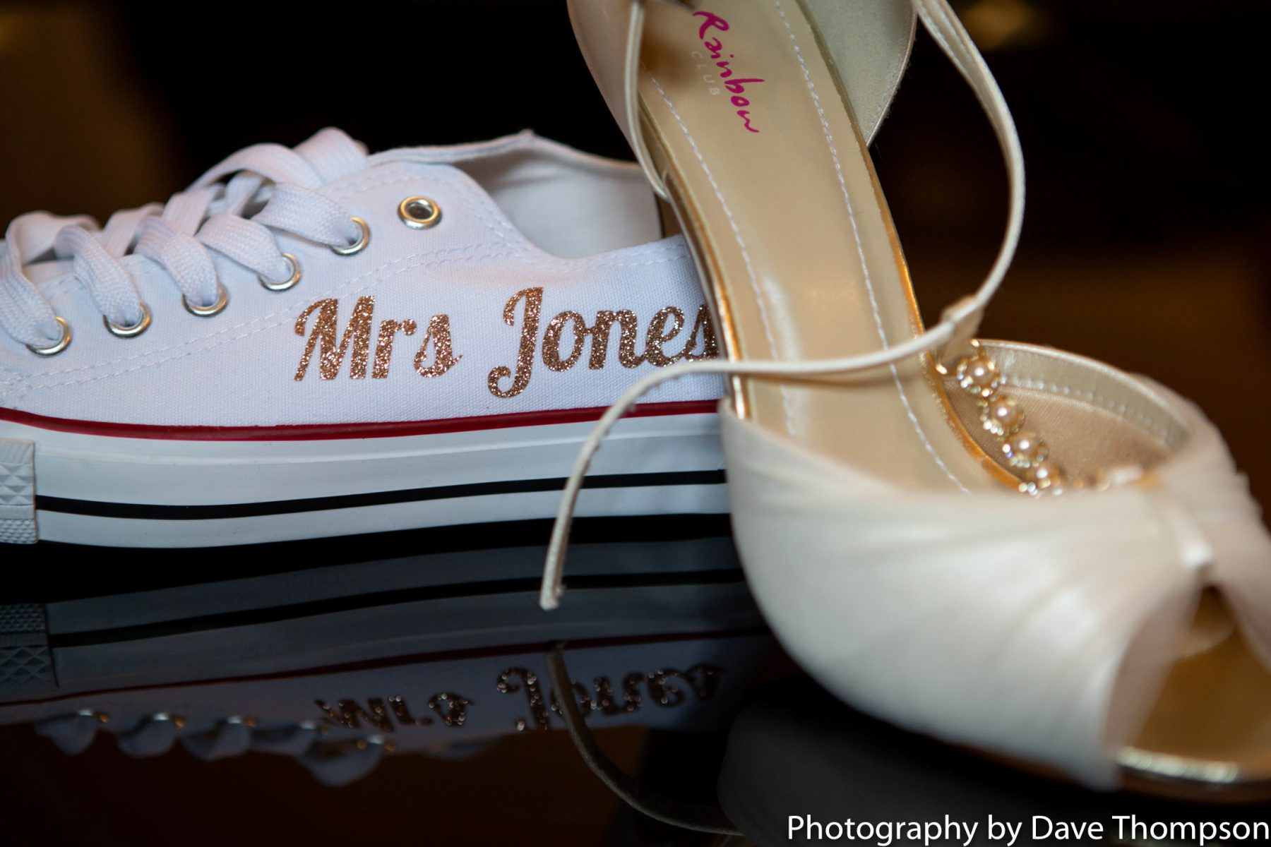 Bridal shoes, a heel and a converse trainer