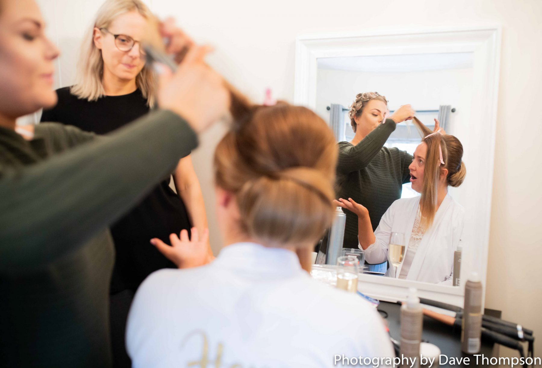 The hairdresser does the brides hair