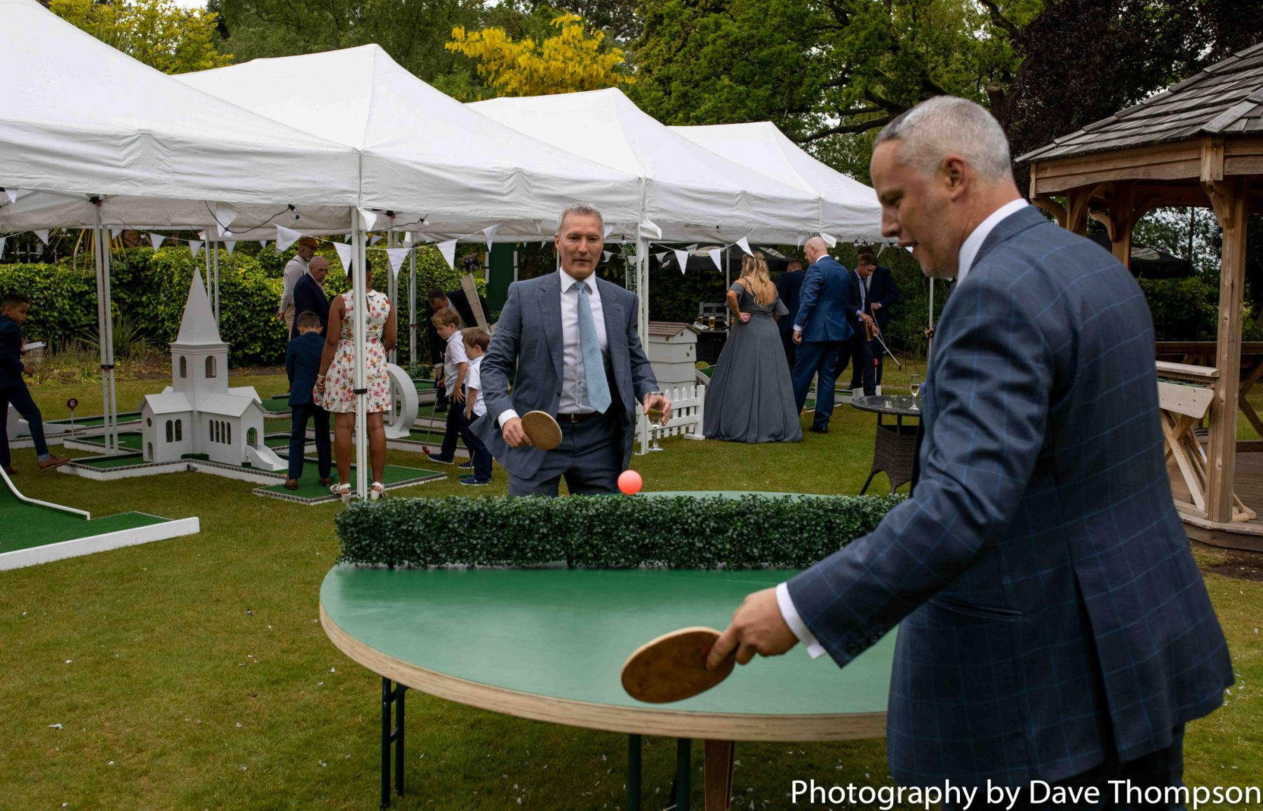 Revolving table tennis on the lawn during a wedding at Mere Court Hotel