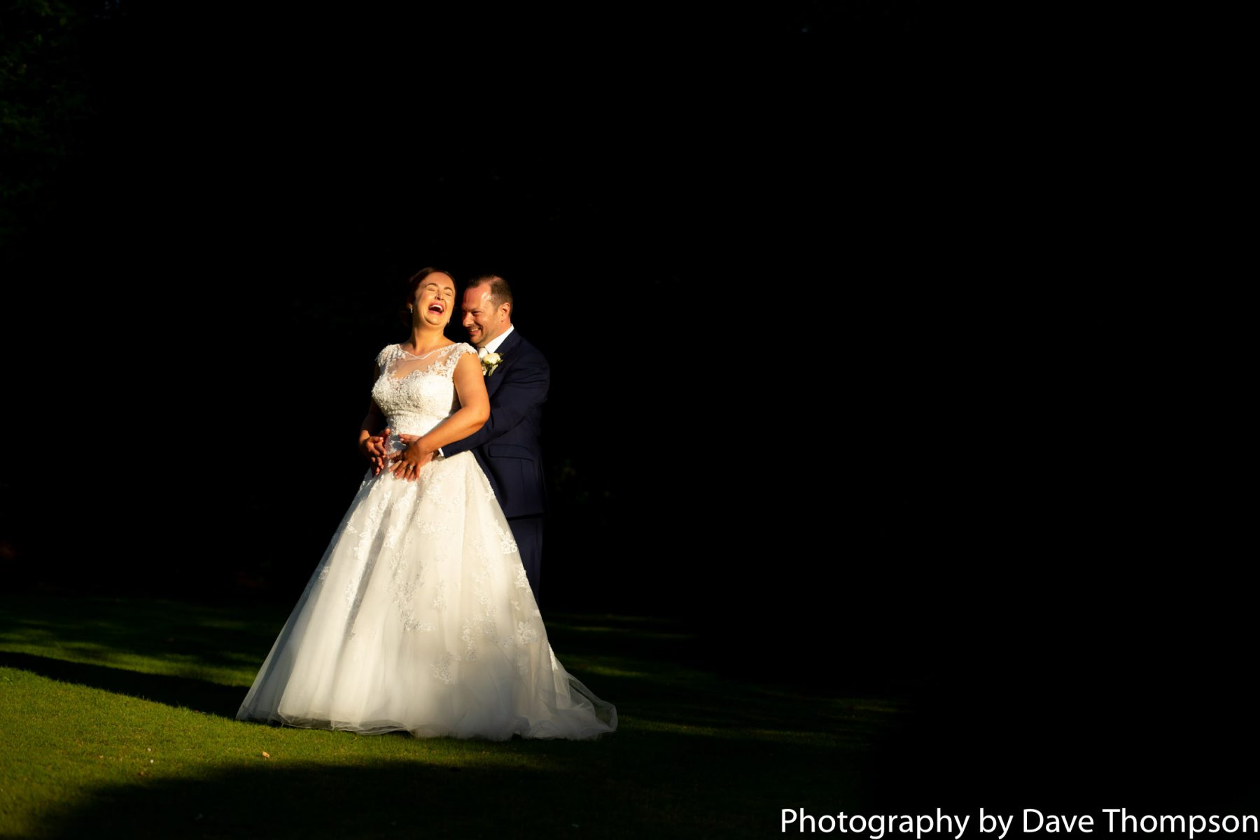 Bride and groom in the early evening sun