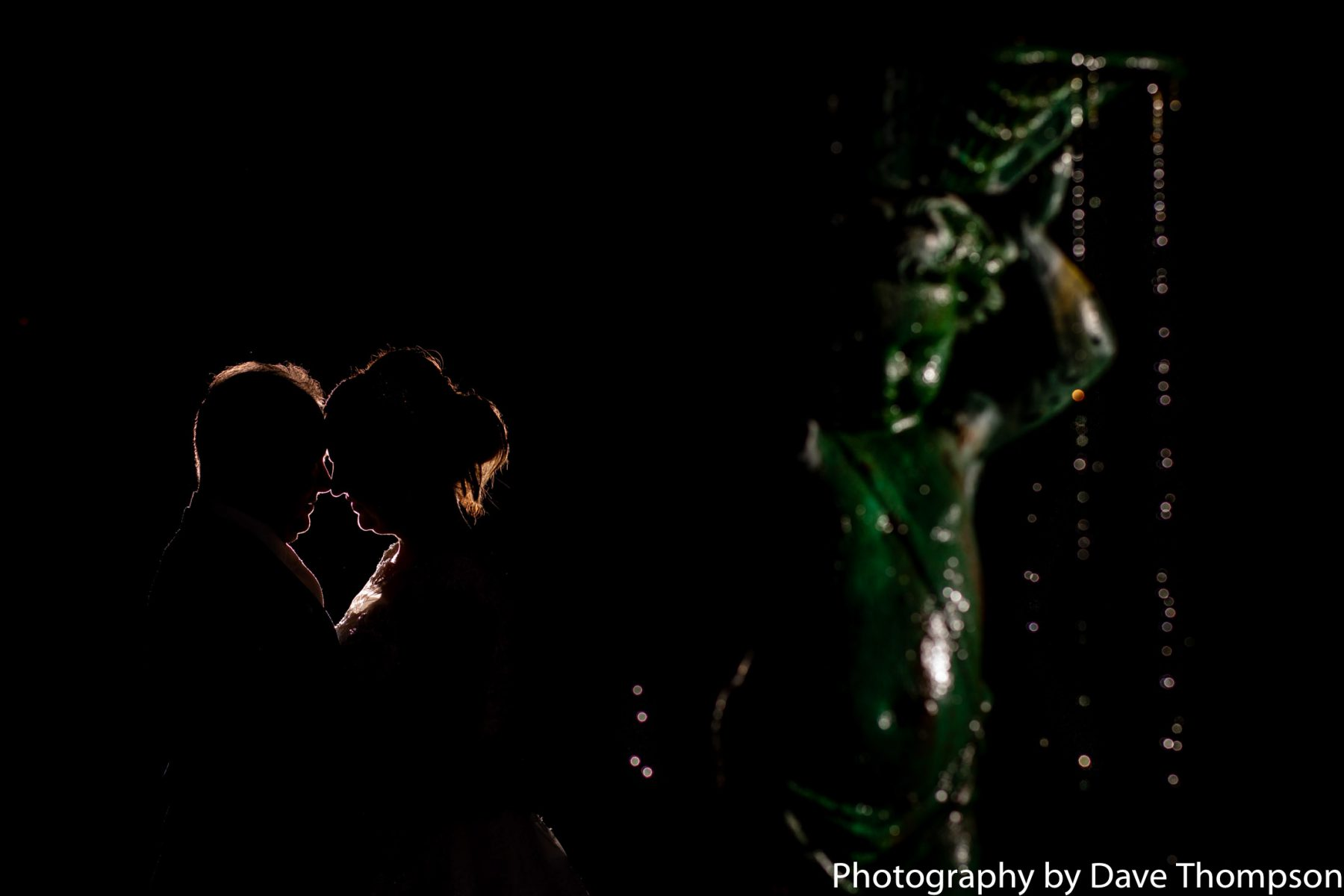 An evening wedding portrait using off camera flash outside the Mere Court Hotel