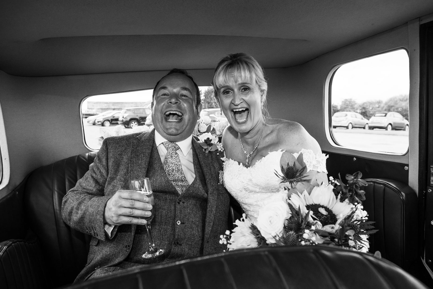 The bride and groom react to the car horn going off