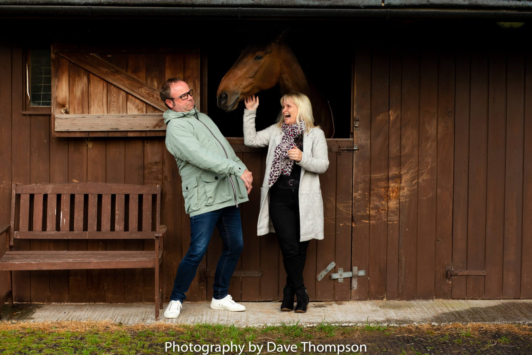 Laughter with a horse during a photoshoot in Cheshire