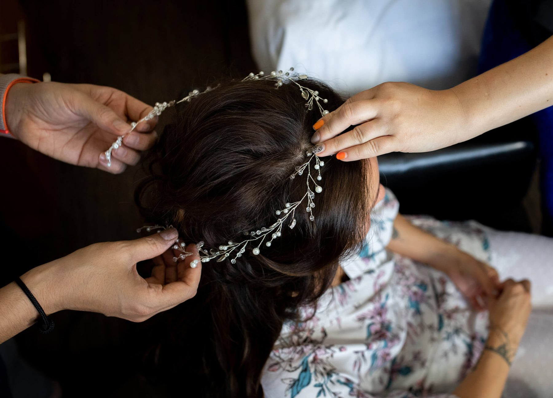 A head piece is put on the brides head