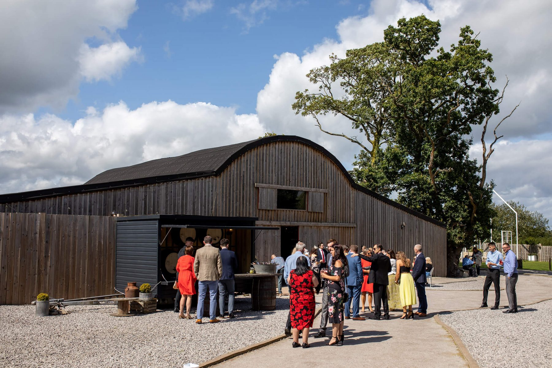 Guests gather outside Alcumlow Barn