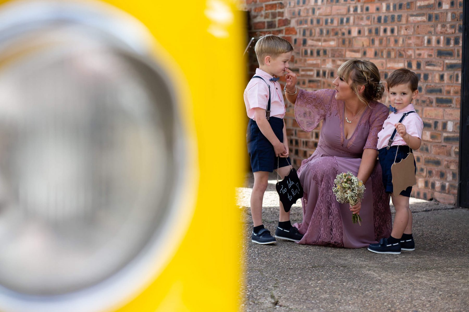 A mother wipes her sons mouth before the wedding
