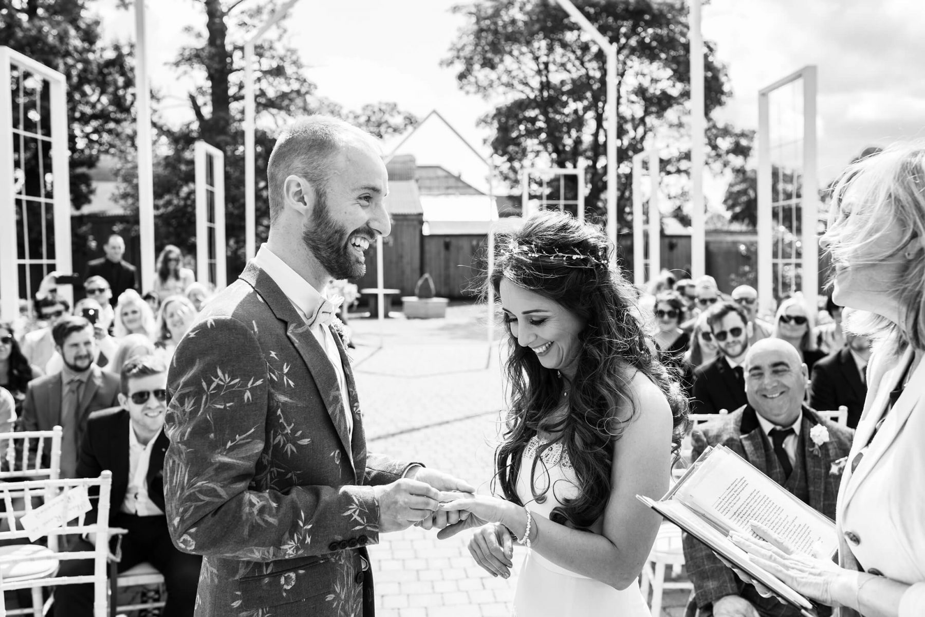 Black and WHite image of the exchanging of rings during the wedding ceremony