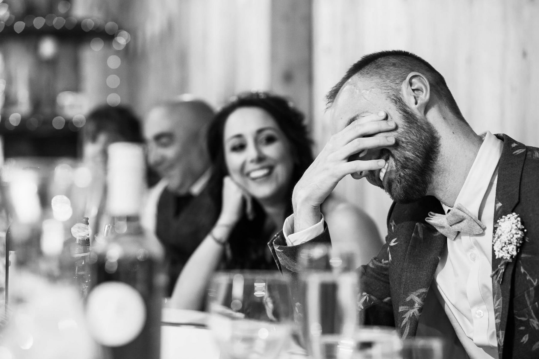 The groom reacts during the best mans speech