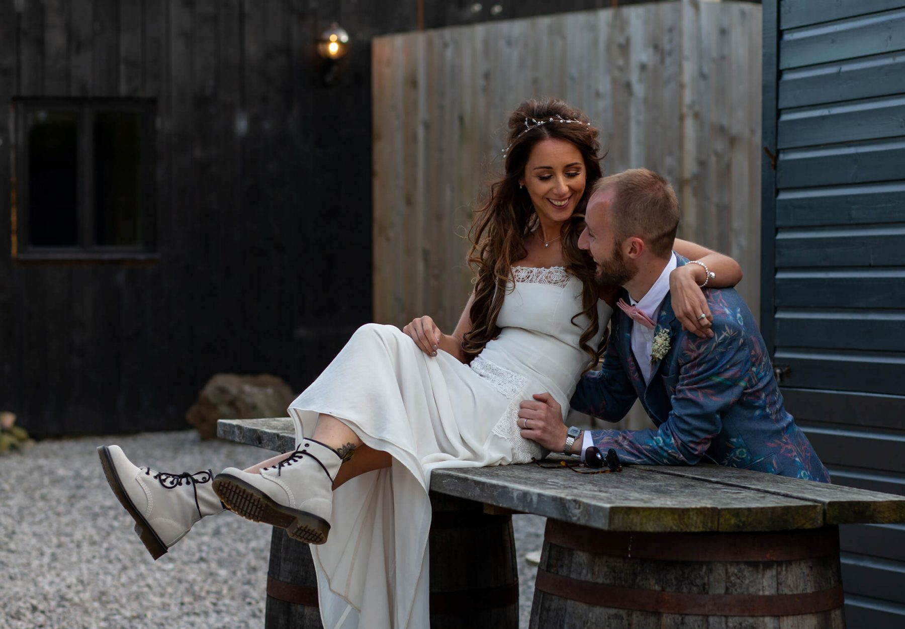 A bride in Dr. Martens boots with her groom
