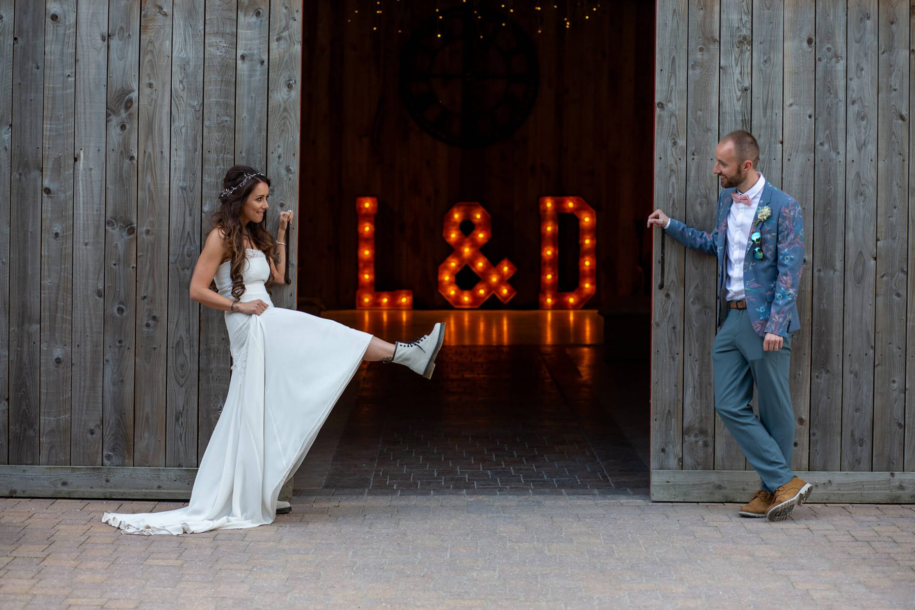 The bride and Groom in front of the letters of their initials