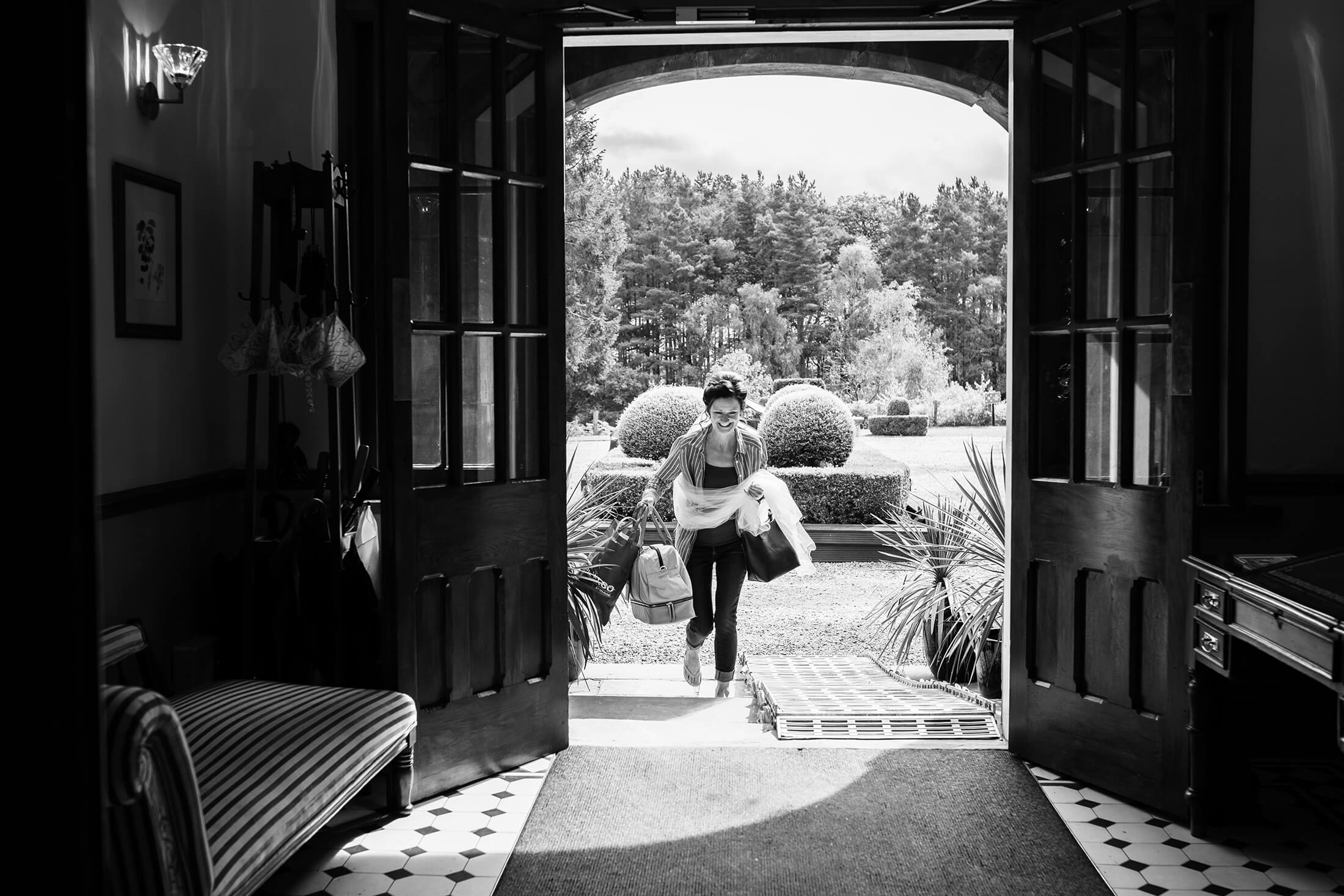 A bride arrives for her wedding at Nunsmere Hall in Cheshire