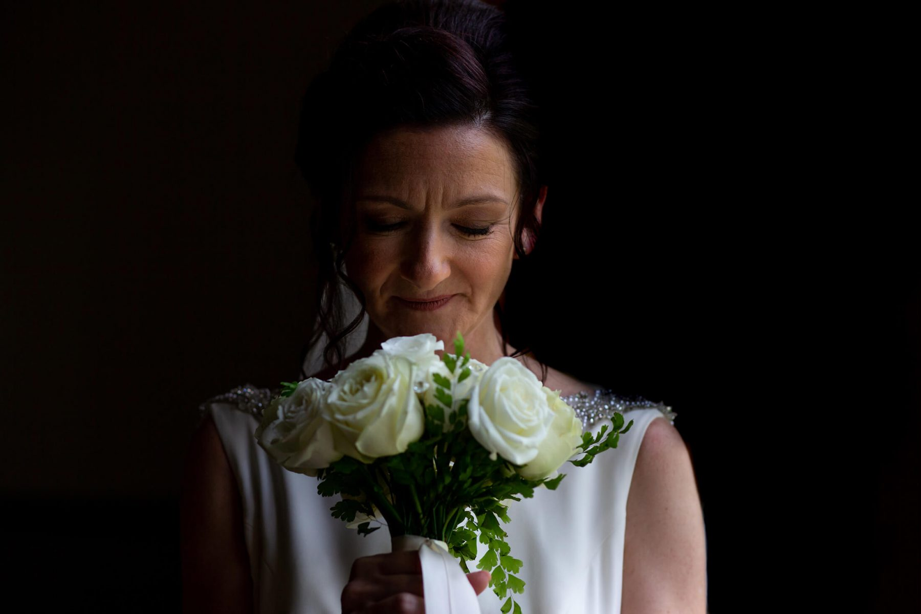 A bride holds her bouquet.