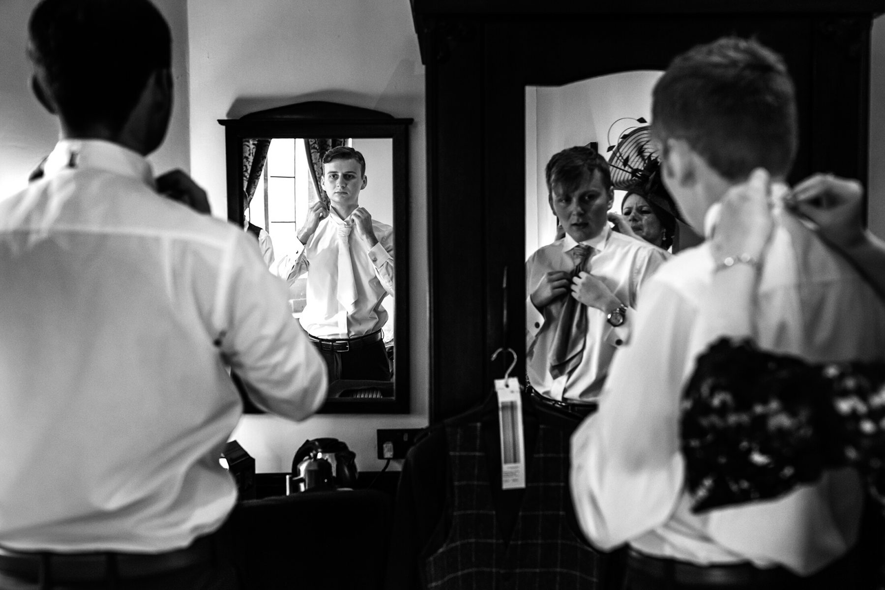 A groom gets ready prior to he wedding at Peckforton Castle