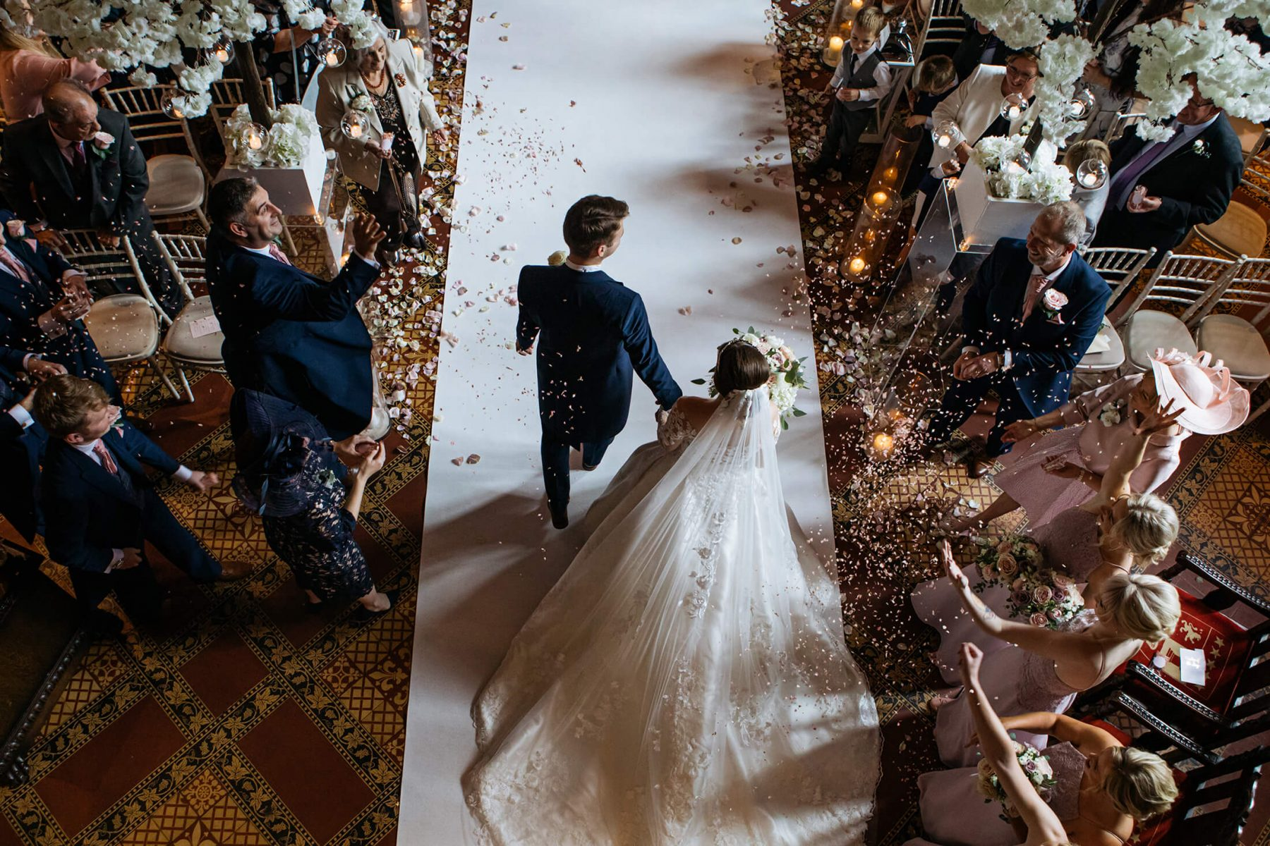 A photograph looking down on the bride and groom after their wedding ceremony at Peckforton Castle