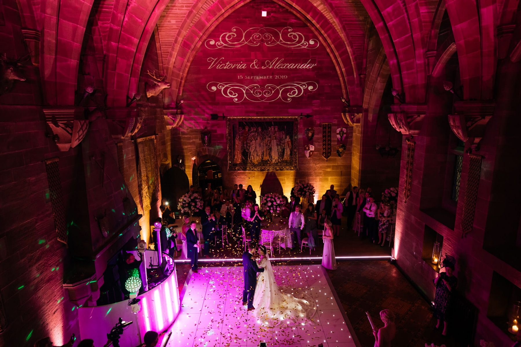 An Ariel image of the bride and groom during their first dance at Peckforton Castle