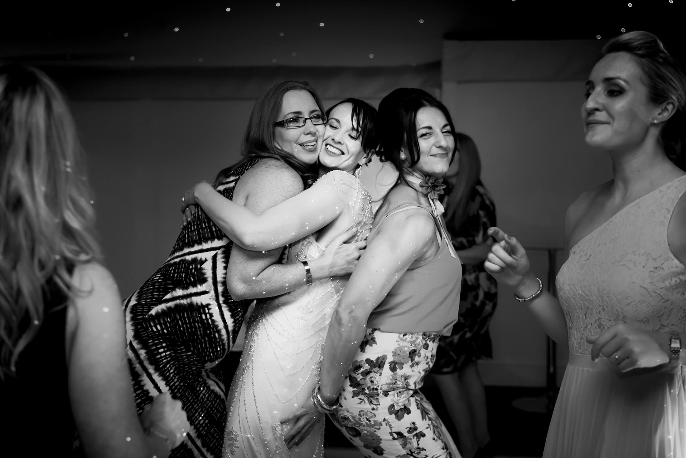 The bride dances with friends following her first dance at Combermere Abbey - Combermere Abbey Wedding Photographer