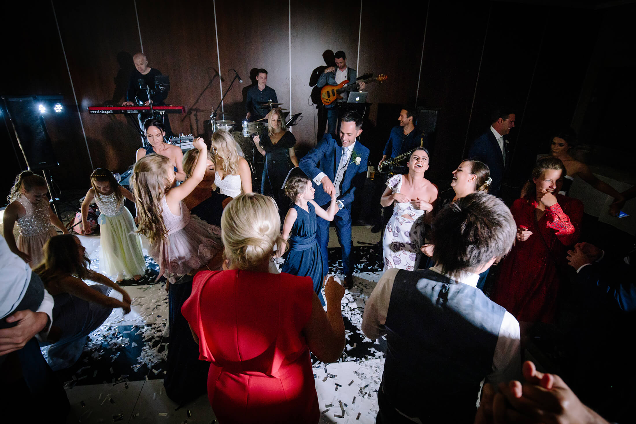 The bride and groom dance with guests after their wedding at the Mere Golf Resort & Spa in Cheshire. Mere Resort Wedding Photographer