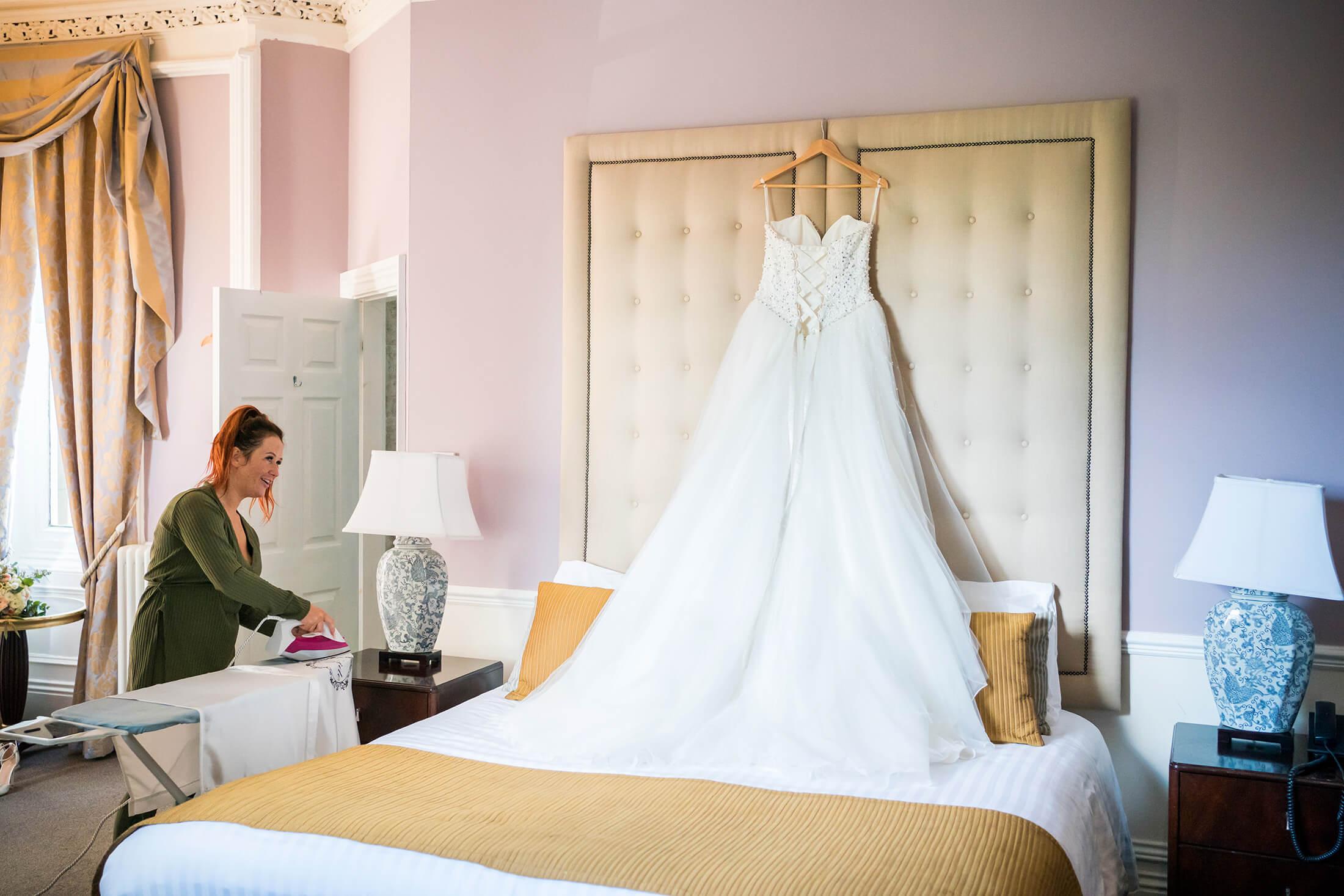Hollin Hall Hotel Wedding Photographer - The bride irons her veil