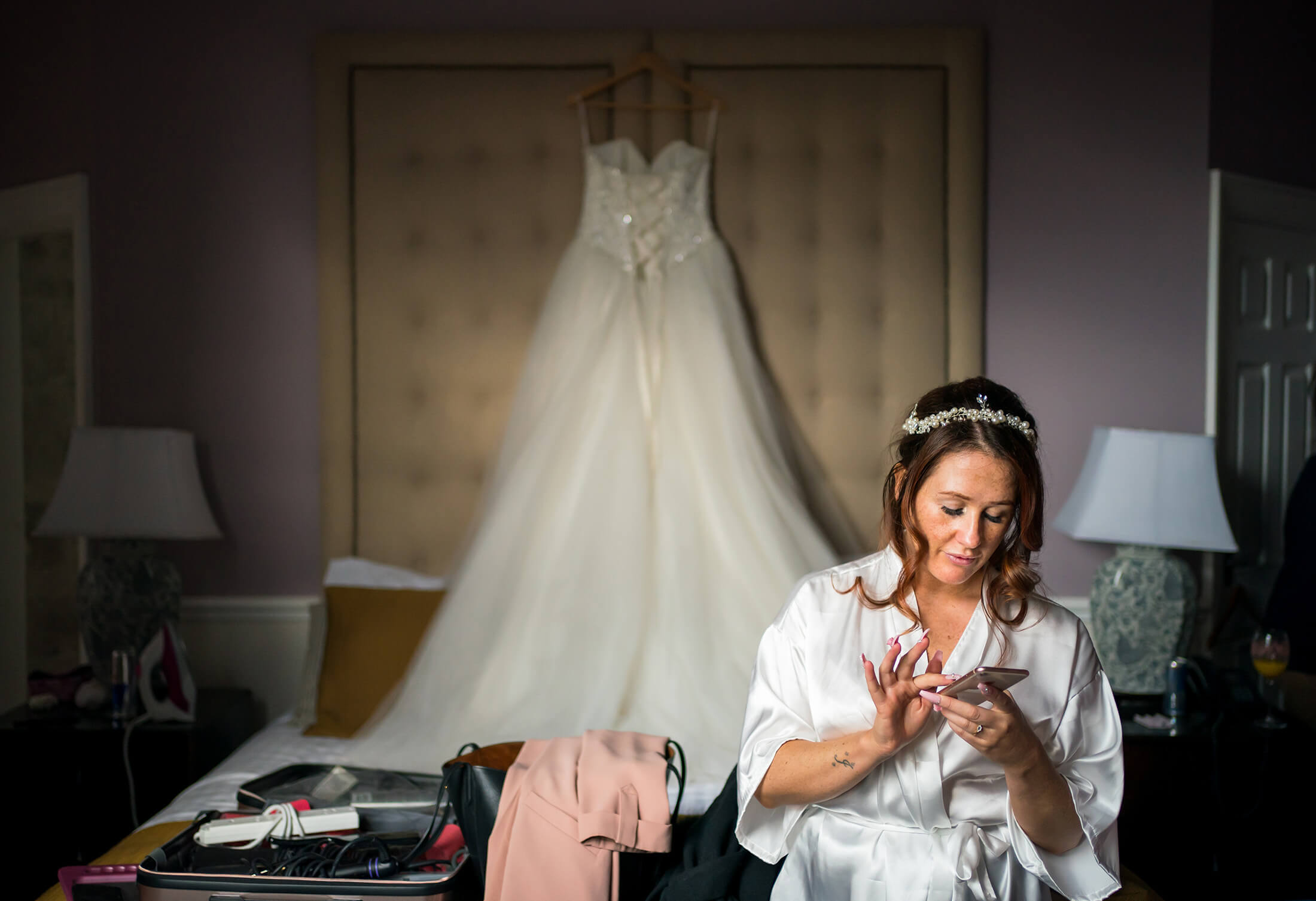Hollin Hall Hotel Wedding Photographer - The bride texts her son