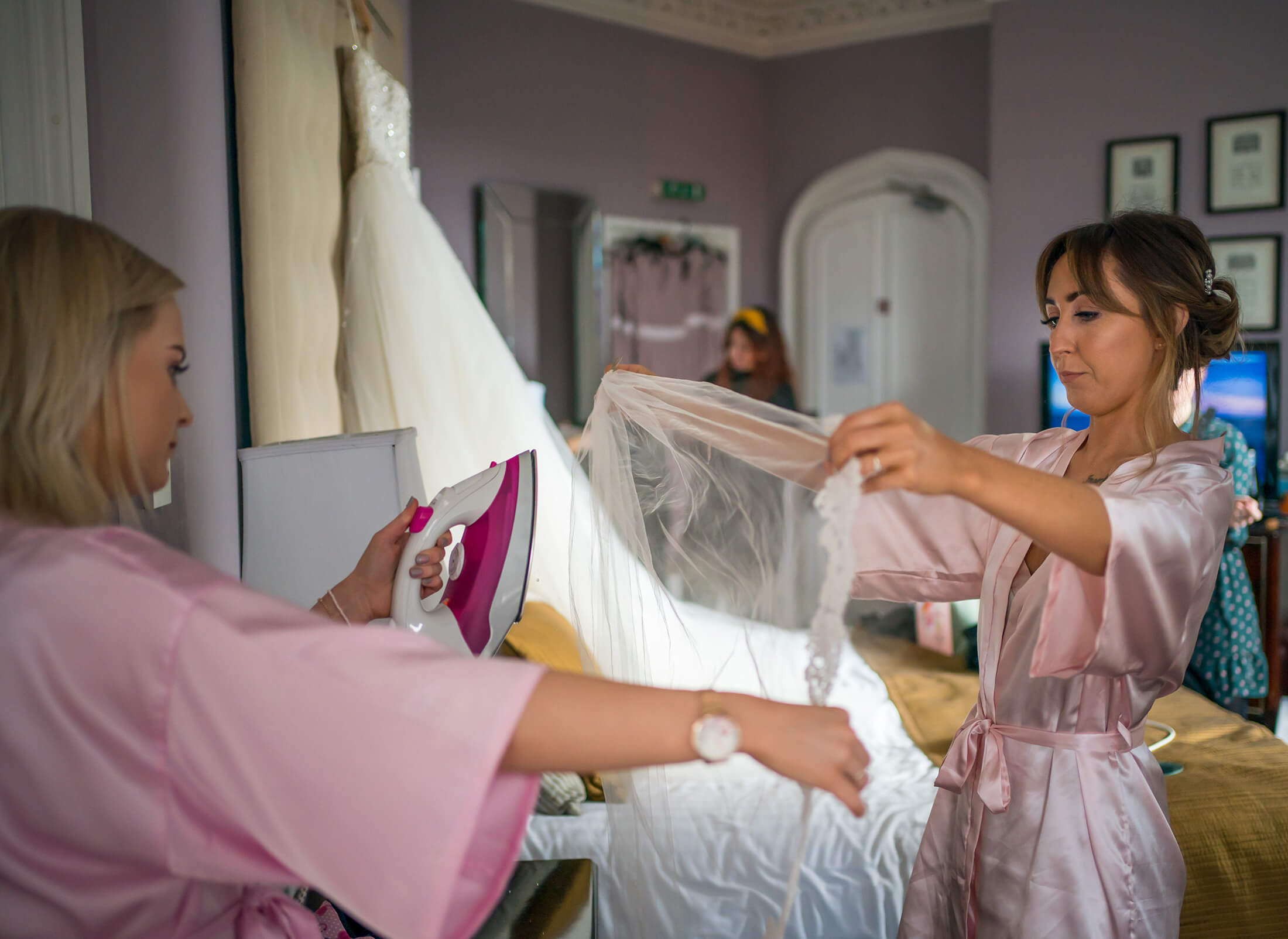 Hollin Hall Hotel Wedding Photographer - The bridesmaids steam the veil