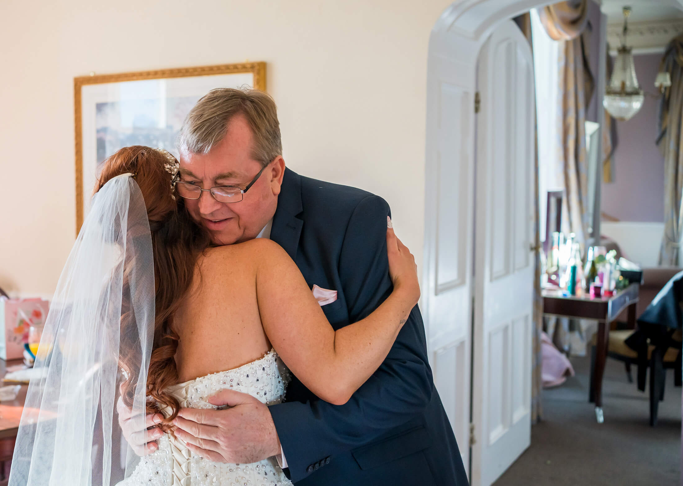 Hollin Hall Hotel Wedding Photographer - The bride has a hug from her father