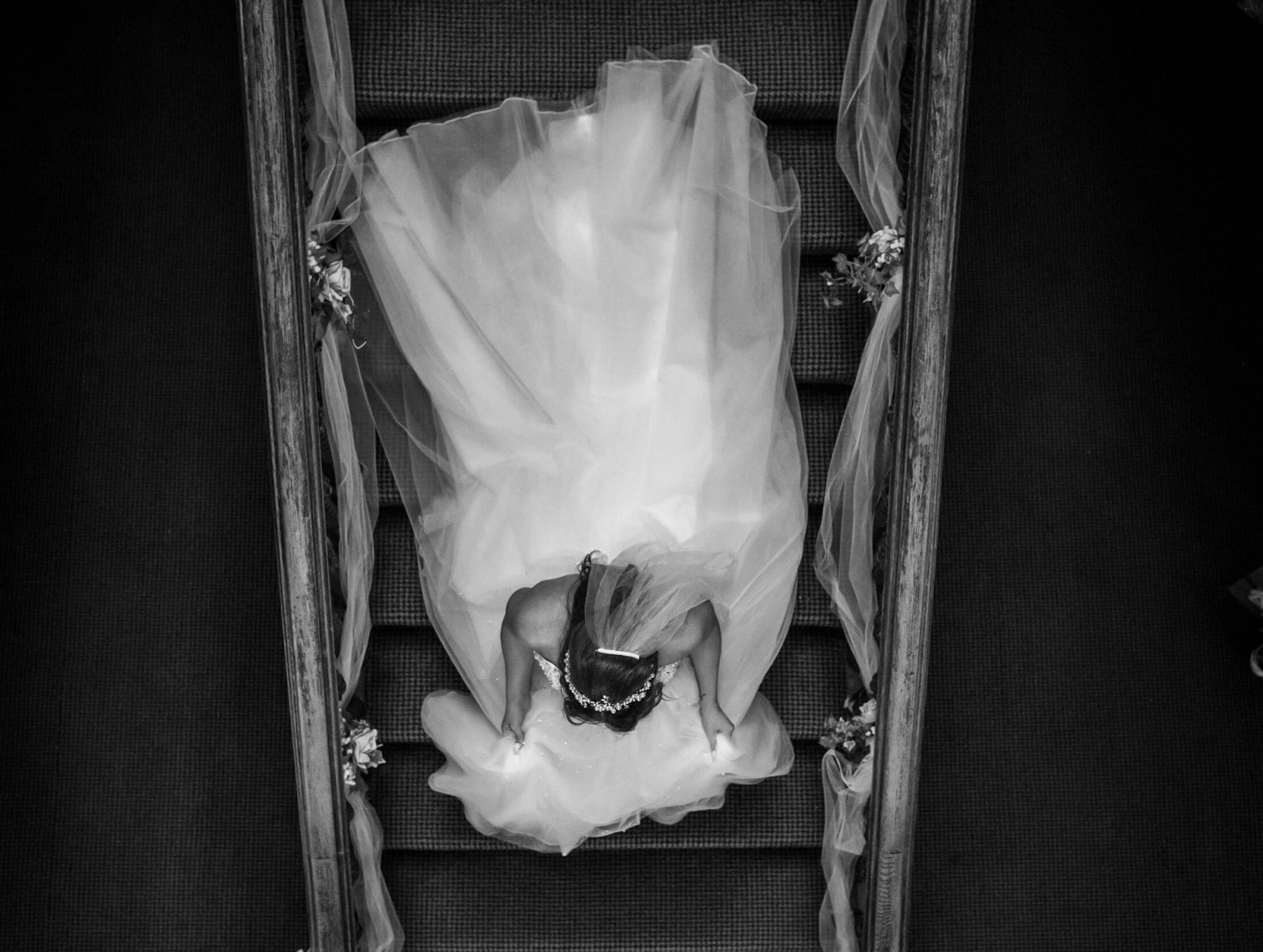 Hollin Hall Hotel Wedding Photographer - A photograph shot from above shows the bride walking donwstairs for the ceremony