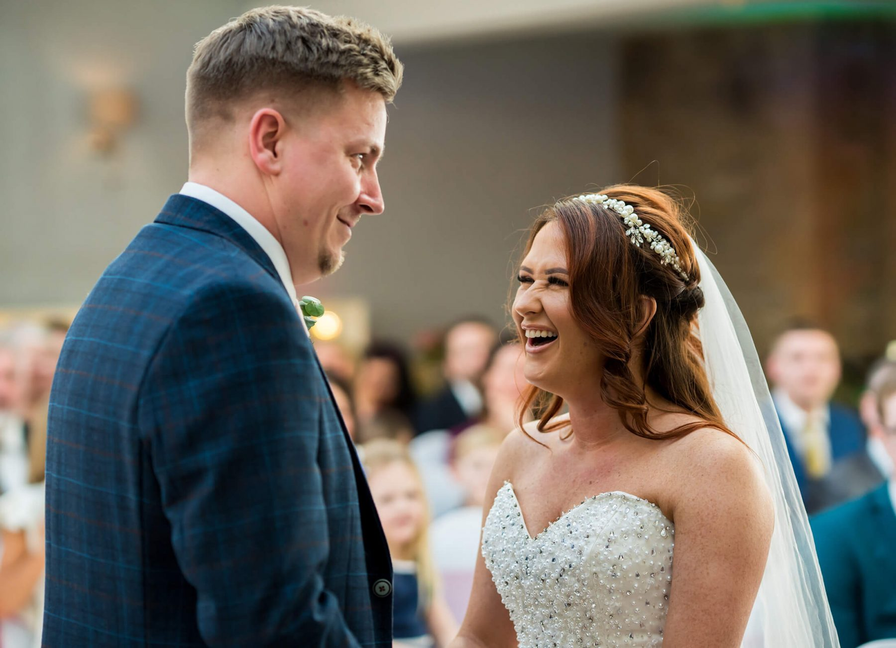 Hollin Hall Hotel Wedding Photographer - The bride and groom laugh during the ceremony
