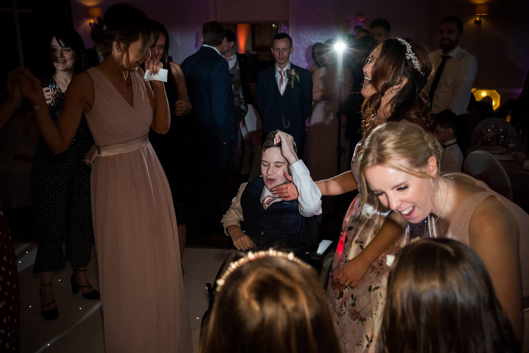Hollin Hall Hotel Wedding Photographer - The bride's son dances in his wheelchair during the first dance