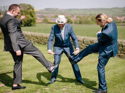 The groom checks his groomsmen shoes