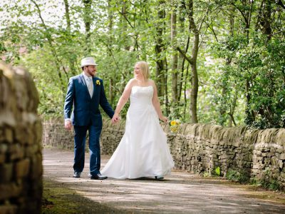 Bride and Groom walking down a country lane