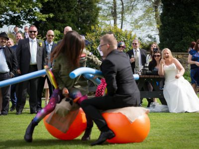 The bride laughs at garden games