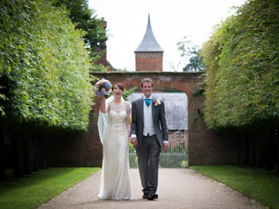 The bride and groom walk up the pathway