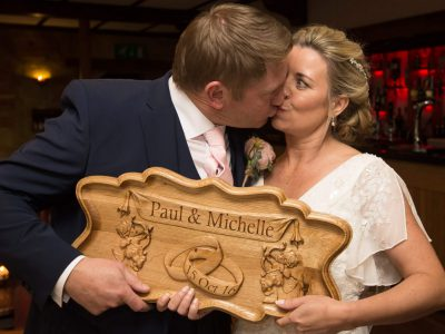 The bride and groom with a gift
