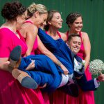 Bridesmaides lift the groom