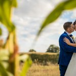 The bride and groom in a corn field