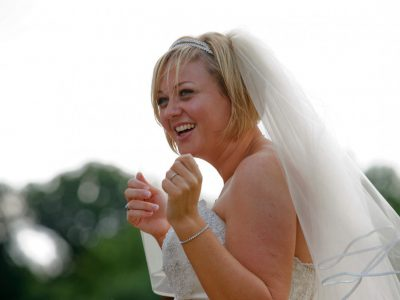 The bride laughs as she walks around the grounds