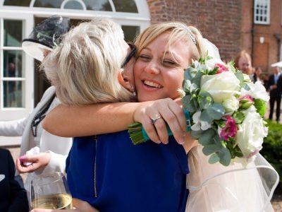 The bride hugs her Auntie